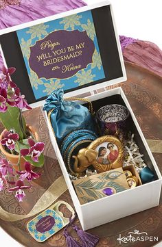 "It's fun to pop the question to your bridesmaids, but how do you get creative when asking your gals, ""Will you be my bridesmaid?"" We gathered a few items from our new Indian Jewel collection to create a ""Bindis and Bangles"" gift box to surprise your girls. It's a cute and unique gift, especially for South Asian brides or for brides with a jewel tone wedding theme!"