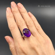 This natural large Amethyst ring is a crystallized fairytale dream come true! This purple rain themed beauty will dazzle you with sparkling showers of violet light from it's faceted cabochon.  This oval shaped statement ring is set in sterling silver and has gorgeous deep natural purple color. Amethyst is a February birthstone and this ring is genuine amethyst! Be aware of rings on the market that claim to be amethyst, but are just purple glass, lab-made amethyst or cubic zirconia!