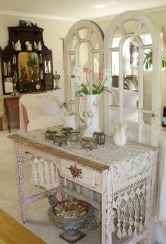 Use a table and screen to make an entryway when the room does not have one