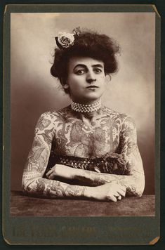 Mrs. M. Stevens Wagner, half length portrait, facing slightly right, arms and chest covered with tattoos. C.1907