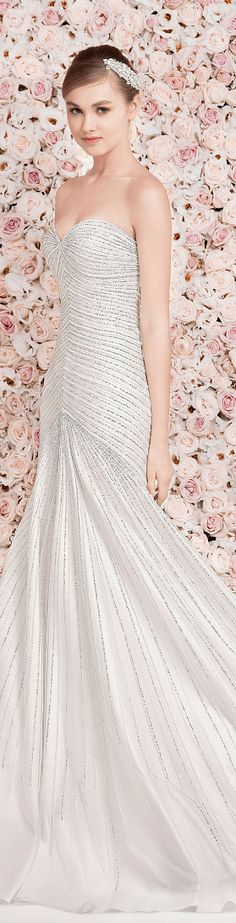 Georges Hobeika Bridal. I'm actually re-pinning this for the WALL OF ROSES! Great idea for a wedding or engagement photo shoot! Gorgeous backdrop.