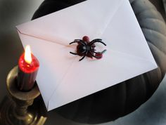 sealed with a spider - this would be cute for handing out halloween party invites or cards