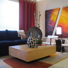 Living room idea: bright, colourful and modern. Plus it pulls in the orange and chrome pieces already in the house