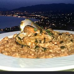 Seafood risotto by kastraki restaurant  Served with the Messinian gulf