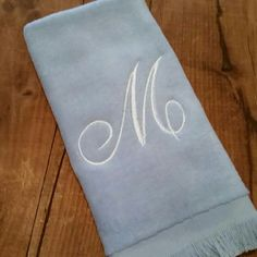 Love this color combination,  light blue fingertip towel with white thread and the M in the Script font!