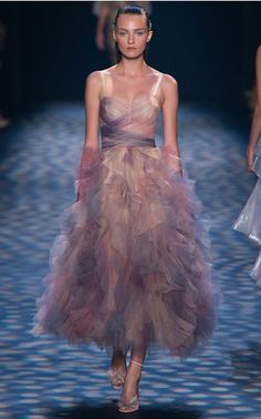 The Designers: Dreamlike eveningwear is Georgina Chapman and Keren Craig's signature. <br><br> This Season It's About: Layers of tulle, iridescent fabrics and flutter sleeves. Grecian gowns and Seventies deep-Vs prove fairytale gowns span the ages. <br><br> The Piece to Buy: The ice blue column dress with a ruffled bustle.