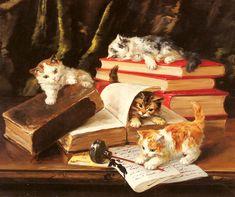 alfredbruneldeneuville kittens playing on a desk