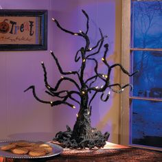 """Wire Ghost Tree with LED Lights - OrientalTrading.comWire Ghost Tree with LED Lights. Not a single leaf will be found on this ghostly wire tree. With its long spidery branches, this tree adds a spook-tacular Halloween glow to your October party festivities. The lights on the tips of the branches glow an eerie shade of orange. 24""""H x 14""""W. Requires 3 """"AA"""" batteries, not included. © OTC  $25.00 Each"""