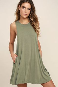 The RVCA Sucker Punch 2 Olive Green Swing Dress has a hard-hitting look that can't be beat! Soft and stretchy jersey knit shapes this sleeveless swing dress with a high neck, and side-seam pockets. Logo tag at hem.