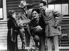 Mary Pickford with her fellow co-owners of the then new United Artists Pictures - L-R, Mary Pickford, D.W. Griffith, Charlie Chaplin & Douglas Fairbanks. United Artists was signed into being by these famous four Feb 5, 1919.