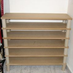 MDF boards +toilet paper cardboard cylinders= shoe storage  you could sand the shelves  paint this to suit your tastes ~ Kel