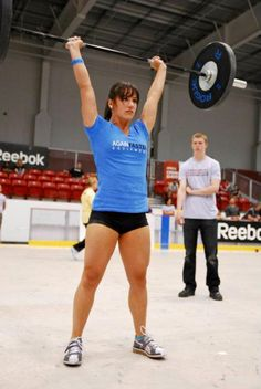CrossFit Camille Leblanc-Bazinet blue graphic tee black pro shorts grey white shoes weightlifting