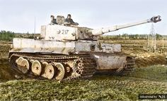Panzer ace Otto Carius and his Tiger I Ausf.E mid production ,# 217, of s.Pz.Abt 502, at the battle of Narva on the Eastern Front,February-March 1944.