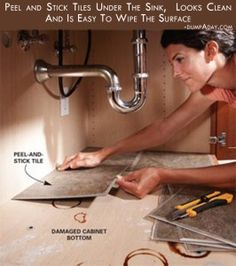 Peel and stick tiles under the sink,  Looks clean and is easy to wipe the surface