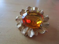 """New Listing Started vintage goldtone floral brooch with faceted amber coloured stone 1.5""""across £2.25"""