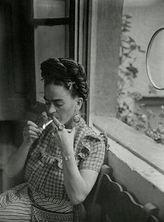 Frida Kahlo smoking.