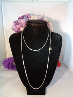 Vintage Les Bernard Extra Long Silvertone Chain with Signed Tag and Barrel Clasp. This Vintage Silvertone Necklace Measures 35 inches Long. Gorgeous simple dark metal alloy silvertone chain.  See it in my store at  www.CCCsVintageJewelry.com @cococlaymancook