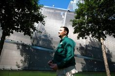 Jeremy DeSimone of Bartlett Tree Experts with some of the trees he helps to maintain at the 9/11 Memorial.