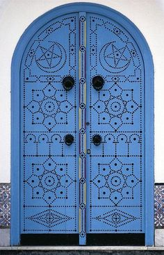 Africa | Sidi Bou Said (Tunisia) is a town that looks like a postcard. All the houses are painted white and the shutters and doors are blue. | Photographer unknown