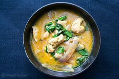 Basil Chicken in Coconut Curry Sauce ~ Basil coconut chicken curry made with chicken thighs, jalapeño, coconut milk, basil and ginger.  Served with hot rice. ~ SimplyRecipes.com
