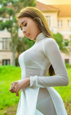 Beautiful Asian Looking Girl in White Vietnamese Dress Sexy Breasts Tease Pose!I Began Using Neckties To Create New FashionAfter collecting a bunch of neckties I find ones that compliment each other and sew them together. Vietnamese Traditional Dress, Vietnamese Dress, Traditional Dresses, Ao Dai, Sexy Asian Girls, Hot Girls, Beautiful Asian Women, Asian Woman, Chiffon
