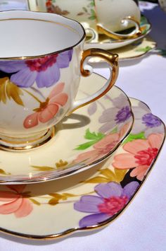 Roslyn China hand painted teacup trio