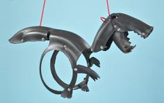 Dino Tire Swing - I've seen the horse tire swing,  but the dino is pretty awesome as well. -S
