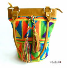 **Beautiful shoulder textile bag handmade by the Wayuu Indigenous Community from Colombia** This unique bag represents the amazing work from the Wayuu Indigenous Women who delicately crochet this...