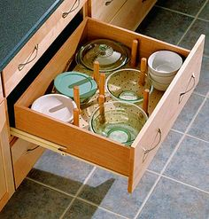 Considering wall O windows instead of upper cabinets.  Idea for plate storage in drawers.