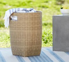 With its thick weave and variegated color, our Torrey Collection captures the organic beauty of wicker and requires no maintenance. This handcrafted basket keeps your pillows, throws and other outdoor essentials within easy reach. Pool Storage, Storage Baskets, Tall Basket, Pool Accessories, Guest Room Office, Decorative Storage, Basket Weaving, Pottery Barn, Wicker