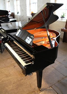 Yamaha Baby Grand. Someday, I want two of these side by side. :)