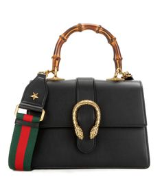 Gucci - Dionysus leather shoulder bag - Gucci's Dionysus shoulder bag comes in a sleek and structured silhouette. A textured double tiger head closure adds feline detail, while the bamboo top handle brings a new carry option. This investment piece comes with two detachable shoulder straps, one featuring the brand's signature red and green stripes. - @ www.mytheresa.com