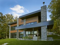 This modern house design features Granada - color Ashland from our range of stone products. The combination of wood, siding and stone make for an attractive, clean and contemporary design! Modern House Design, Contemporary Design, Wood Siding, Granada, Range, Exterior, Mansions, Stone, House Styles