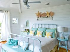 aqua and white with a splash of yellow for a beautiful beach house guest room