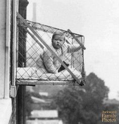 Apparently this was a real thing, parents in NYC high rises had child cages so their babies could get fresh air without going for a walk from AwkwardFamilyPhotos.com
