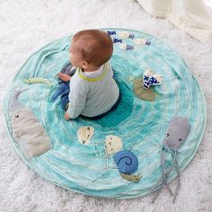Shop Be on the Sea Activity Floor Mat.  Marine themed baby activity mat lets your baby explore the wonders of the seven seas from the comfort of the nursery.