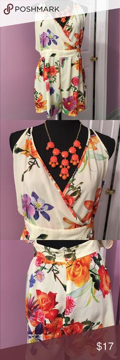 """Floral romper XL Floral romper with bright print, back zip, open back, adjustable spaghetti straps, like new condition.  waist 17.5"""",length from the waist down 14.5"""", 65% cotton 35% polyester Other"""