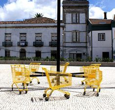 """in a public plaza of Ponta Delgada, Açores, Portugal; """"By counteracting the freedom of movement that normally characterizes these carts (ironically moving in circles) we are reminded that consumerism does not take us anywhere… or [at best back to our] starting point."""" says Nuno Pimenta."""