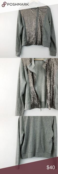 """Juicy Couture Sequin Asymmetrical Zip-Up Jacket Juicy Couture Sequin Asymmetrical Zip-Up Jacket. Grey zip-up with asymmetrical, silver sequined panel. Snap collar closure, zip-up closure. Pockets. 60% cotton, 40% polyester. Approximately 44"""" bust, 23.5"""" long.  Excellent condition.  (G23) Juicy Couture Tops Sweatshirts & Hoodies"""