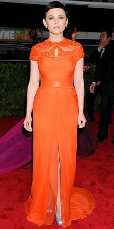 Ginnifer Goodwin in orange Monique Lhuillier evening gown on red carpet
