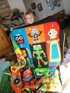 Robot quilt. Wes would absolutely love a robot room! Hmm...