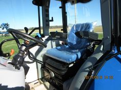 Inside New Holland Boomer 47 cab tractor