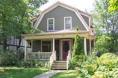 4 bedroom 1906 Dutch Colonial sits perfectly on a large city lot filled with lush gardens and within walking distance of the many lakes in southwest Minneapolis. Dutch Colonial Exterior, Dutch Colonial Homes, Gambrel Barn, Gambrel Roof, Porch Addition, Fenced In Yard, Historic Homes, House Colors, Roof Colors