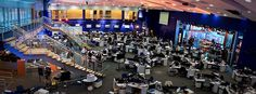 Meet the CNBC newsroom. Can you spot your favorite anchor or reporter? Did you know the open area on the right leads to The Big Wall? Can you count the chairs? Enjoy!