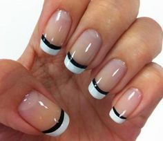 Perfectly shaped white French tips. The nails are coated with clear polish as base and tipped with perfectly shaped white polish and lined with a sleek black acrylic.
