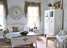 Farmhouse family room at Town and Country Living I like the clock! also the floor mat!