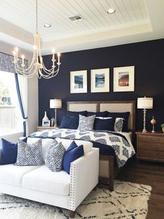 Love the dark navy wall to contrast with the lighter tones in the furniture.