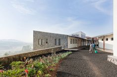 MASS design group: butaro hospital, rwanda one of the hospital's outdoor paths image © iwan baan School Architecture, Architecture Design, Critical Regionalism, Eco City, Ventilation System, Civil Engineering, Paths, Around The Worlds, House Styles