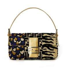 """The Fendi Baguette...the only """"IT"""" bag that I have ever truly coveted. This one is Spring 2003."""
