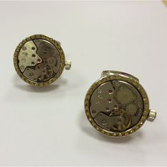 A pair of watch movement stainless steel cufflinks in gold n silver tones.  Approx. 22mm diameter.  Priced at $90.